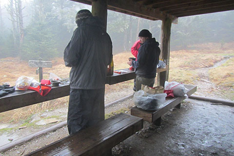 Cooking beneath the shelter