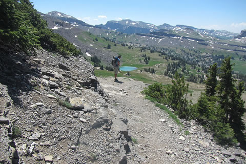 Hiker on the north side of Sunset Lake as he climbs toward Hurricane Pass