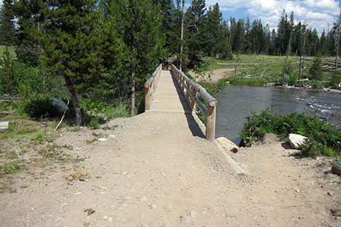 Bridge over the String Lake Outlet leading to the trailhead