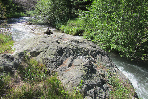 Boulder next to the creek