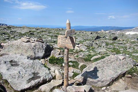 Directional sign at Flattop Mountain summit