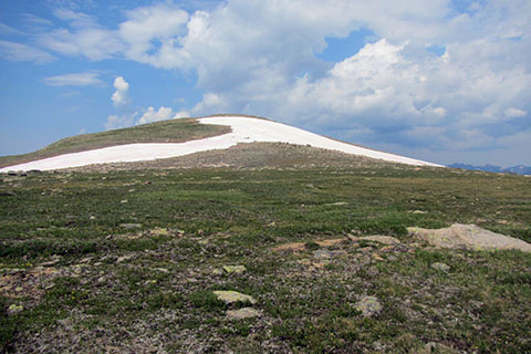 A snowy knob of 12,277 feet to the west of the trail