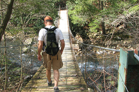 Crossing Cane Creek on a suspension bridge