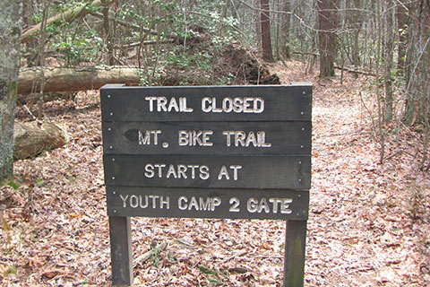 Passing a mountain bike trail closed sign