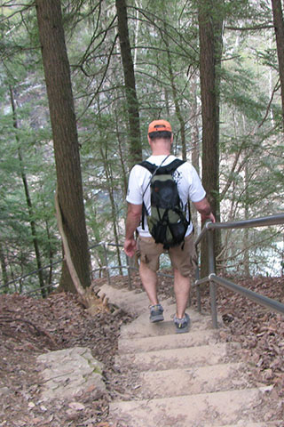 Descending the steps to the suspension bridge over Cane Creek